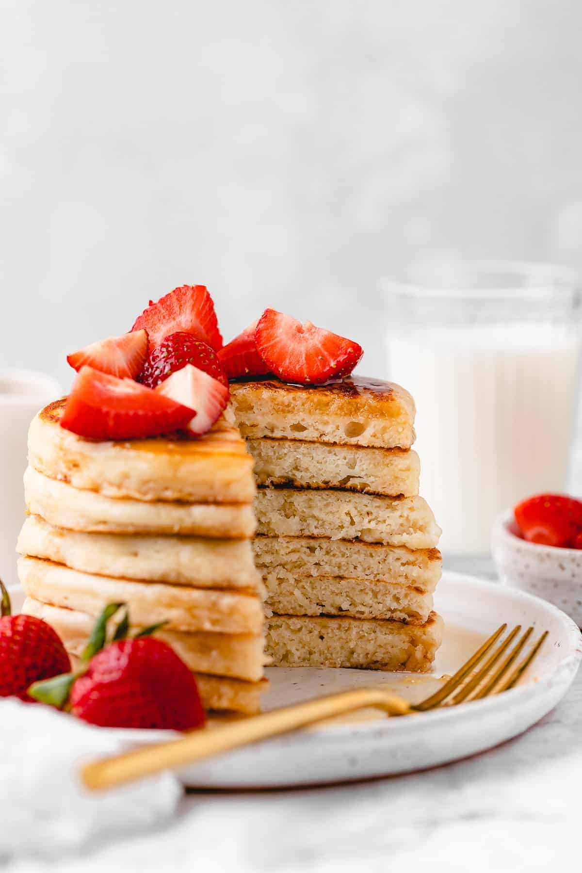 Fluffy vegan pancakes with chopped strawberries.