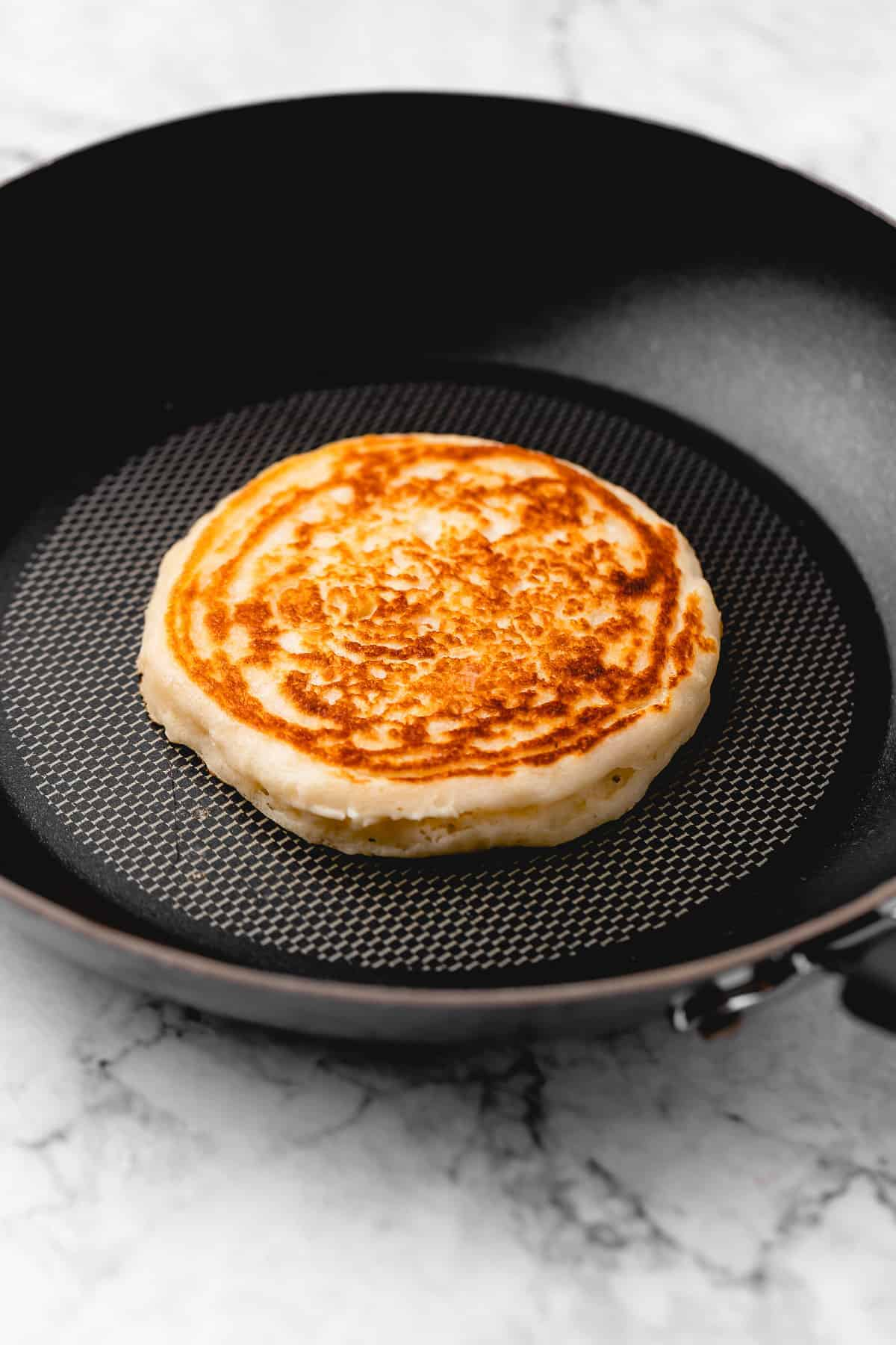 Golden brown pancake in a skillet.