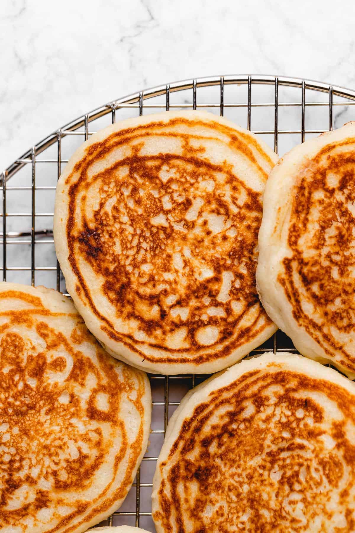 Cooling rack of crispy vegan pancakes.