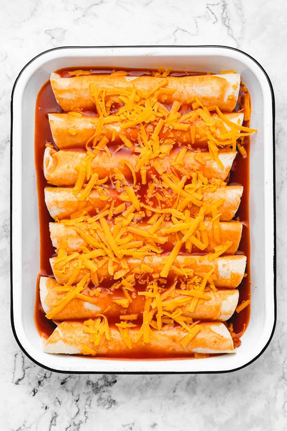 Stuffed tortillas with enchilada sauce and cheese.