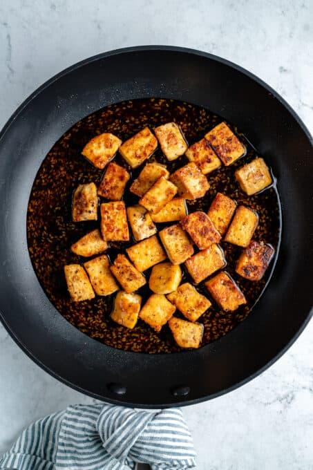 Crispy tofu cubes in teriyaki sauce.