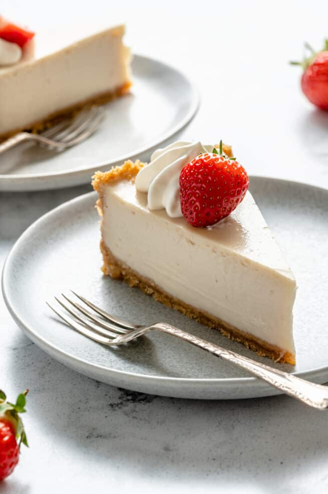 Slice of vegan cheesecake on a plate.
