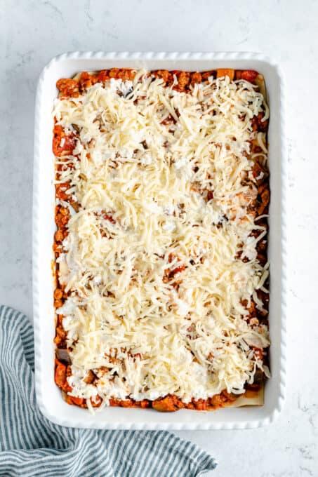 Shredded vegan mozzarella on top of vegan ricotta.