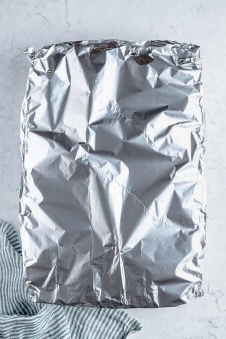 Aluminum foil covering a baking dish.