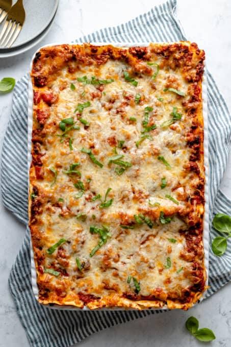 Baked vegan lasagna in a baking dish.