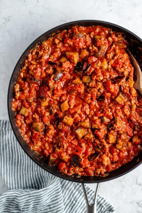 Vegan meat and eggplant cooking in tomato sauce.