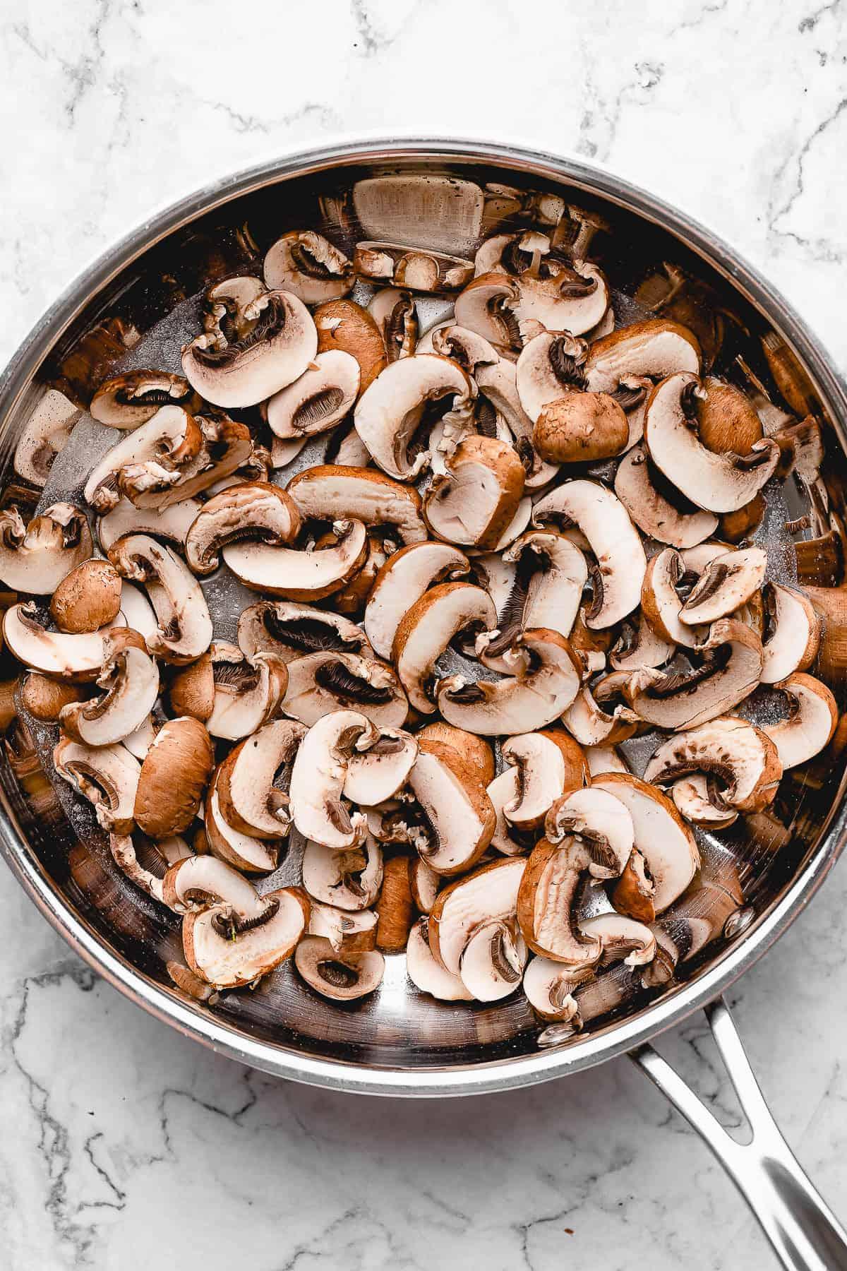 Pan of sliced mushrooms.