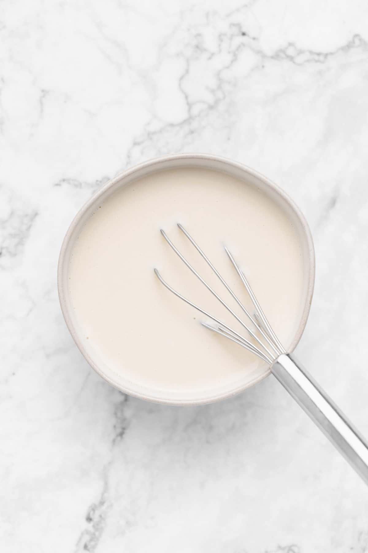 Vegan buttermilk in a bowl.