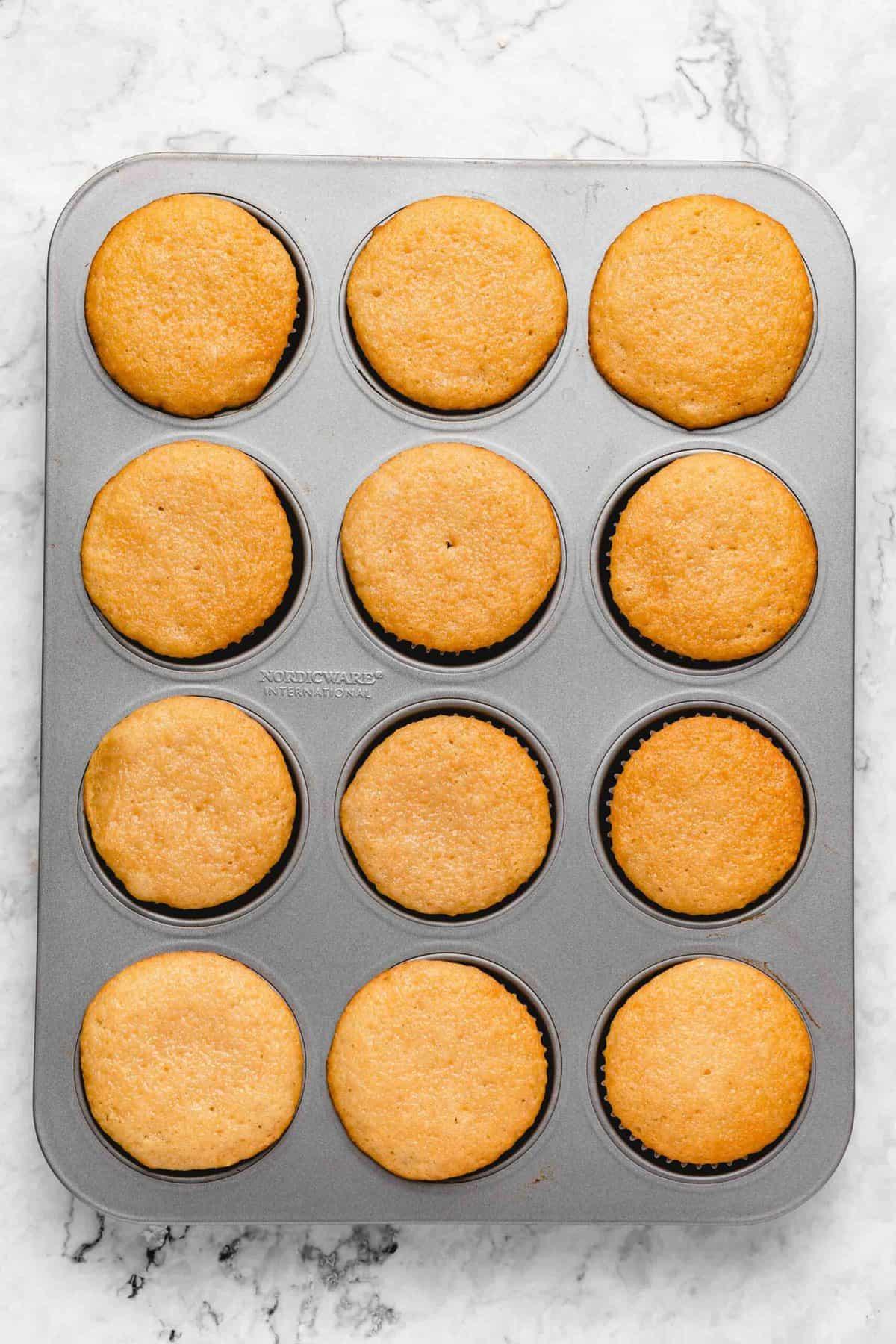 Baked cupcakes in a cupcake pan.