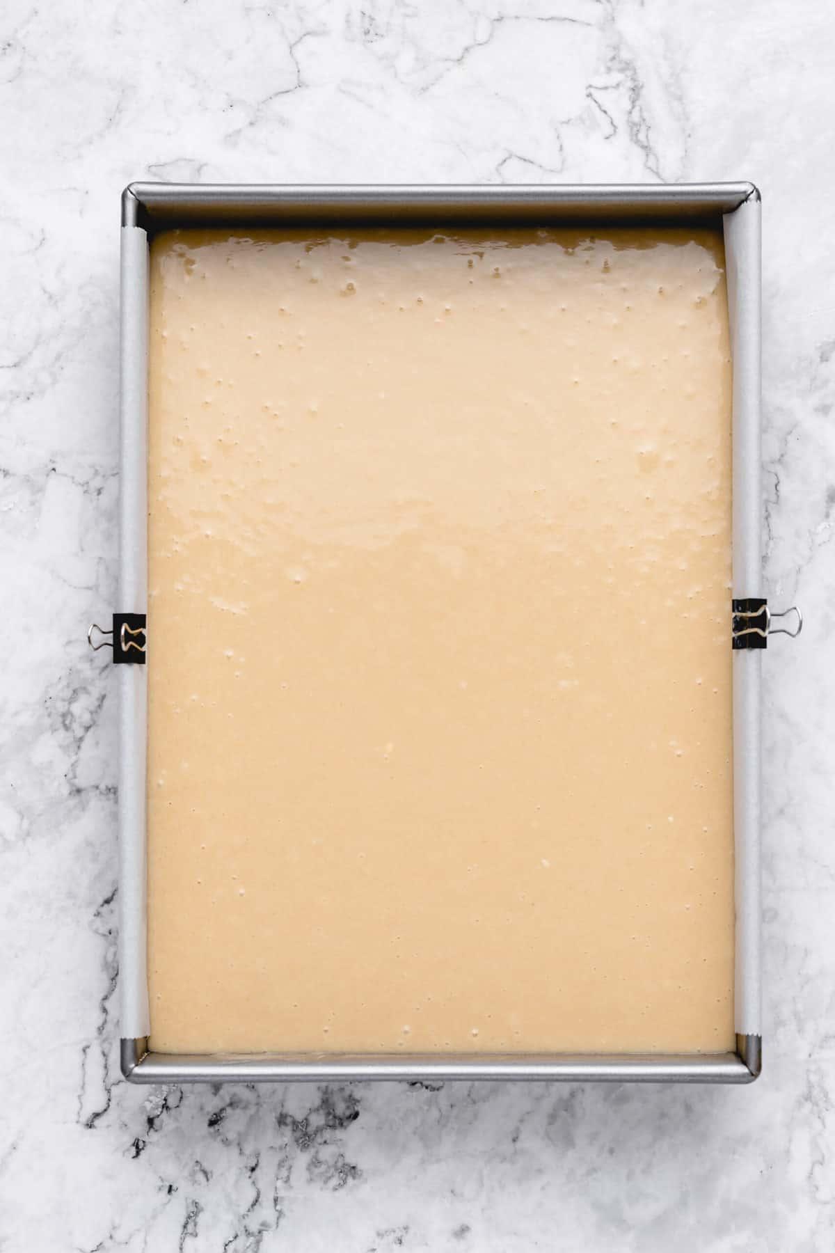 Cake batter in a sheet pan.