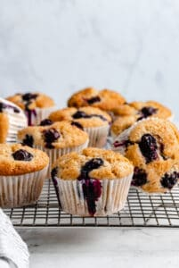 Blueberry muffins in wrappers.