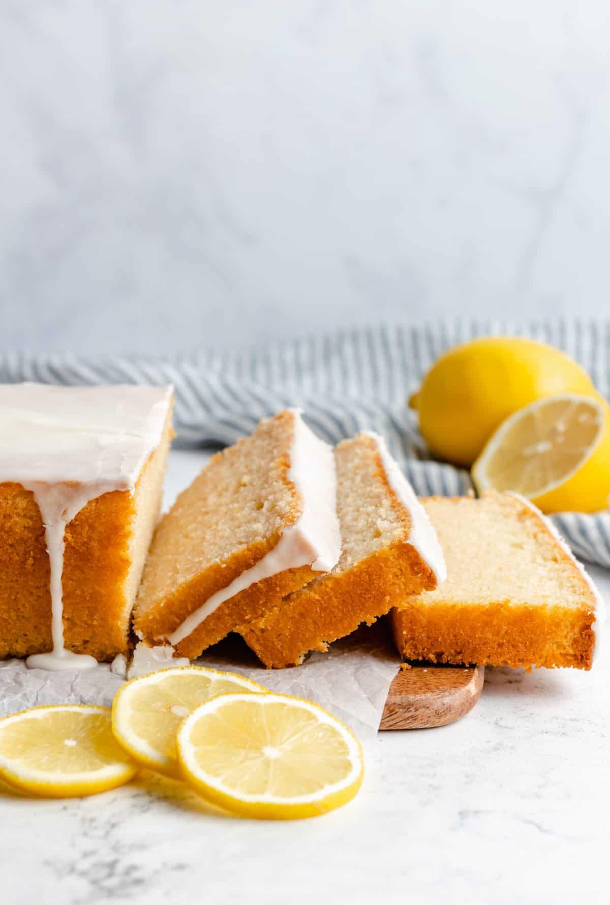 Sliced loaf of vegan lemon quick bread.