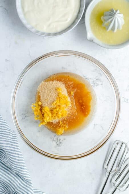 Sugar, oil, and lemon juice in a bowl.