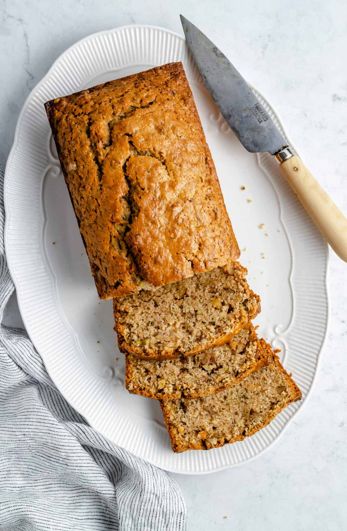 Sliced loaf of zucchini bread.