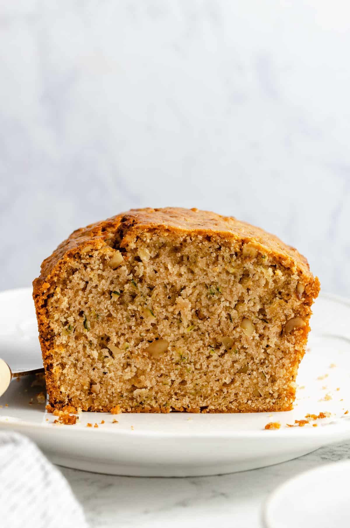 Loaf of bread with grated zucchini and walnuts.