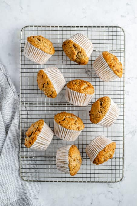 Cooling muffins in muffin wrappers.