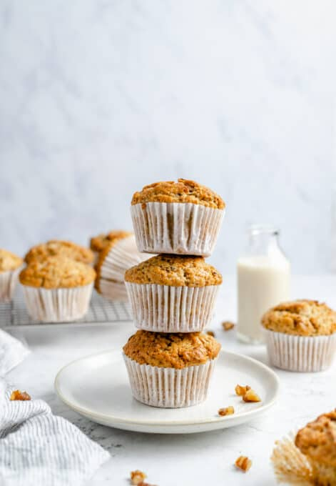 Three stacked muffins on a plate.