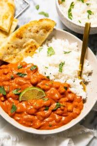 Spicy vegan tikka masala with rice and naan.