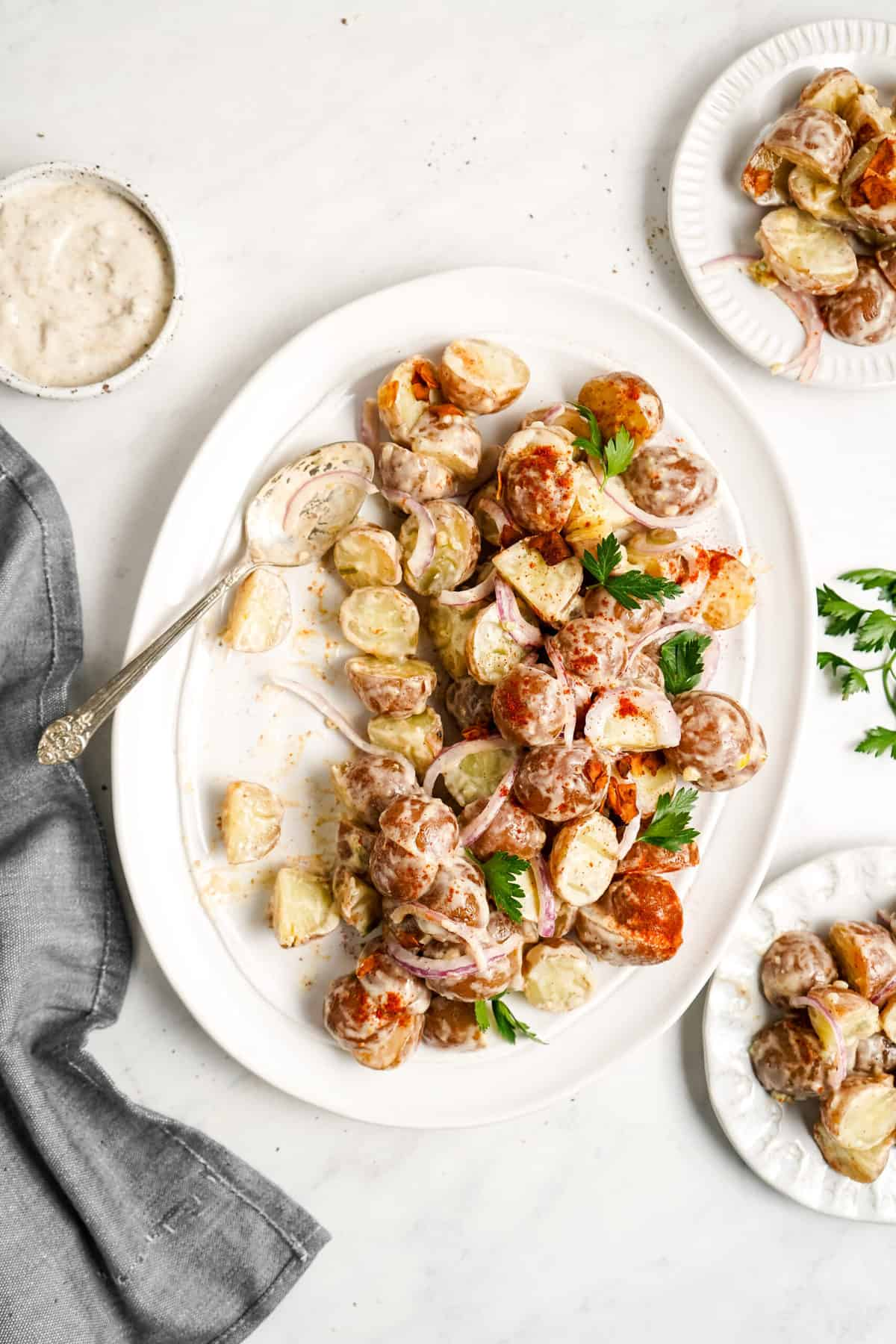 Potato salad with red onion and coconut bacon.