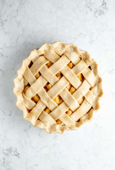 Pie crust filled with apples and covered with a lattice.